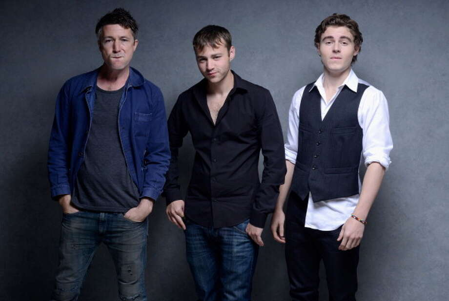 """Aidan Gillen, left, trades his slimy Littlefinger character for another unlikable man in new movie """"Beneath The Harvest Sky,"""" with co-stars Emory Cohen, center, and Callan McAuliffe, right. It debuted at the Toronto International Film Festival on Sept. 8, 2013. Photo: Jeff Vespa, WireImage / 2013 Jeff Vespa"""