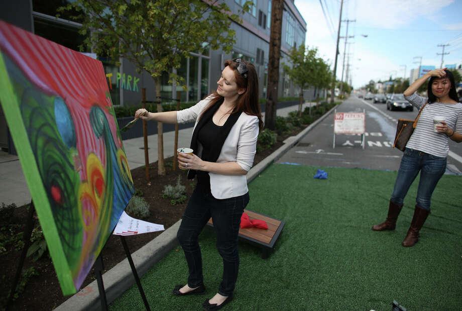 Angelique Ashton works on a community painting in the Interbay Worklofts space during PARK(ing) Day on 15th Avenue West. Photo: JOSHUA TRUJILLO, SEATTLEPI.COM / SEATTLEPI.COM