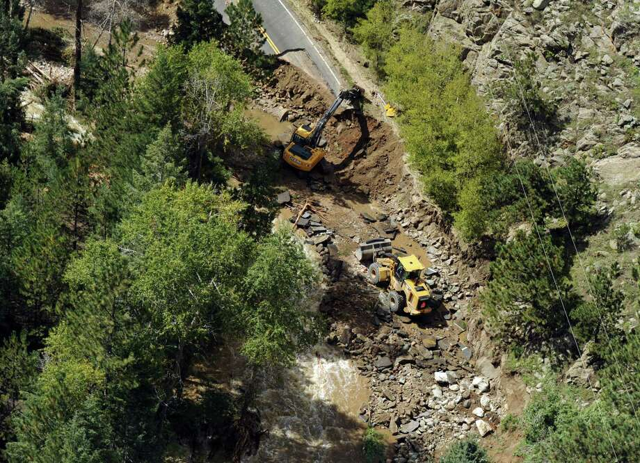 Heavy equipment is seen on a road outside Boulder, Colo. Flooding has damaged more than 200 miles of state highways. Photo: Joe Amon / Associated Press