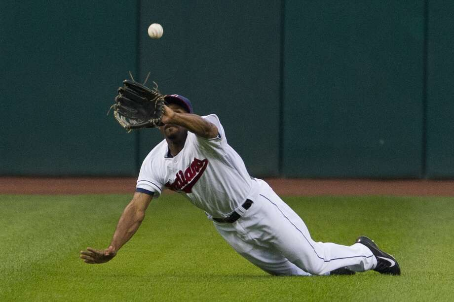 Center fielder Michael Bourn #24 of the Indians catches a fly ball hit by Jonathan Villar. Photo: Jason Miller, Getty Images