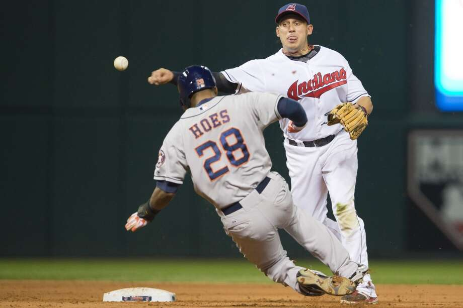 Shortstop Asdrubal Cabrera #13 of the Indians throws to first for the double play. Photo: Jason Miller, Getty Images