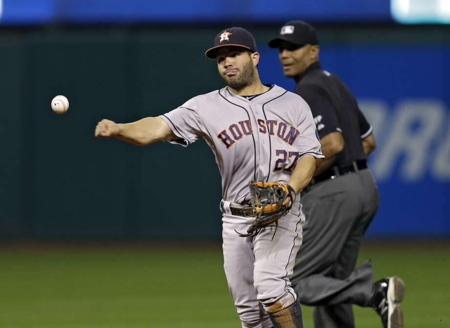 Astros second baseman Jose Altuve throws out Michael Brantley at first. Photo: Mark Duncan, Associated Press