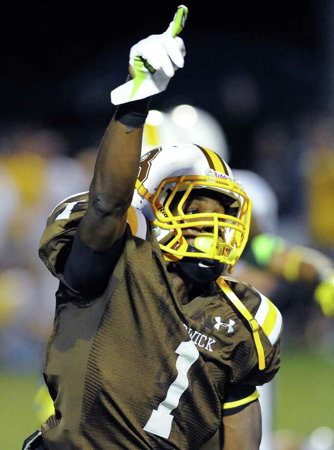 Malik Wilder (# 1) gives the # 1 sign during the high School football game between Brunswick School and Kent School at Brunswick in Greenwich, Friday night, Sept. 20, 2013. Photo: Bob Luckey / Greenwich Time