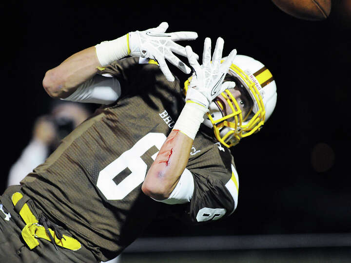 Charlie Cobb of (# 6) Brunswick misses on a pass reception during the high School football game b