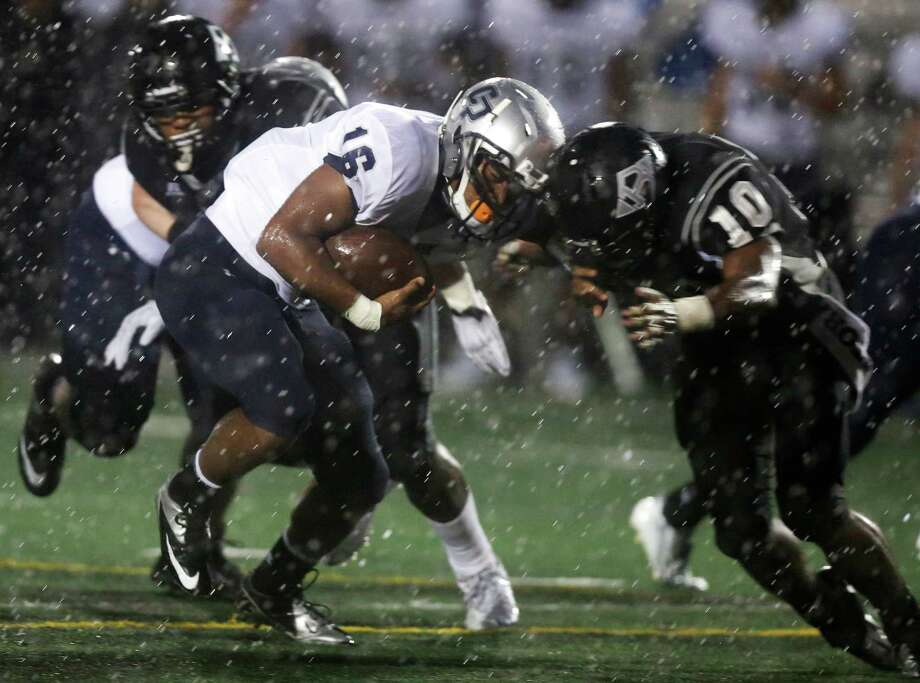 College Park running back Nicholas Black (16) is hit by Clear Brook safety Tim McCray (10) during the first half of a high school football game at CCISD Veterans Memorial Stadium on Friday, Sept. 20, 2013, in League City. Photo: J. Patric Schneider, For The Chronicle / © 2013 Houston Chronicle
