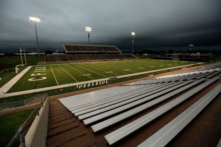 Rain clouds cover Pridgeon Stadium before a high school football game between Cy-Fair and Langham Creek resulting in a game suspension and spectator evacuation of the stands Friday, September 20, 2013. Photo: Eric Christian Smith, For The Chronicle