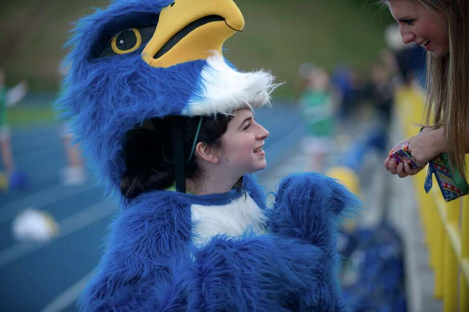 "It was Clare Hebert's, 16, first day on the job as the Newtown High School mascot, the ""Night Hawk"" during a Newtown boys football game against Bethel High School at Newtown High School, Newtown, Conn on Friday, September 20, 2013. Photo: H John Voorhees III"