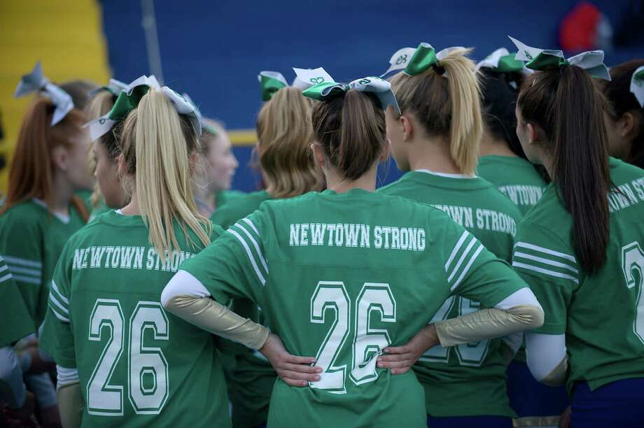 The Newtown High School cheerleaders wore special jerseys for the Sandy Hook Memorial Game at Newtown High School, Newtown, Conn on Friday, September 20, 2013. Photo: H John Voorhees III