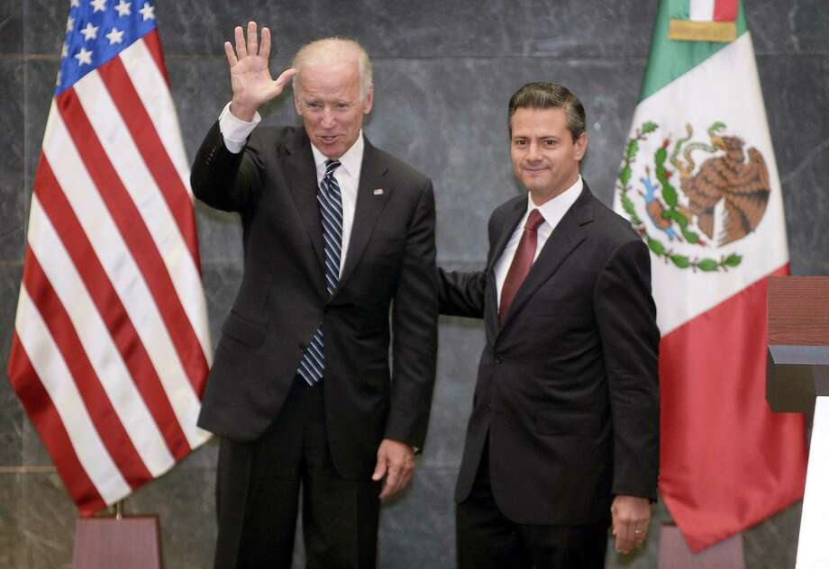 Vice President Joe Biden waves next to Mexican President Enrique Pena Nieto in Mexico City. In addition to economic partnership, the two discussed increasing student exchanges and joint research. Photo: Alfredo Estrella / Getty Images