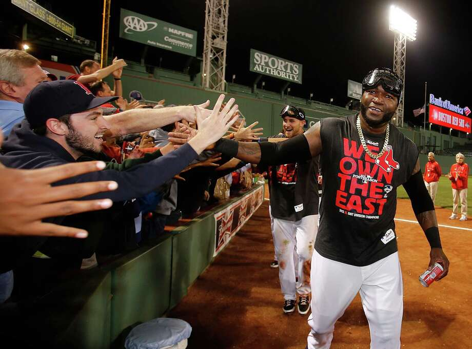 BOSTON, MA - SEPTEMBER 20: David Ortiz #34 of the Boston Red Sox and Will Middlebrooks #16 interact with fans after winning the AL East Division by beating  the Toronto Blue Jays at Fenway Park on September 20, 2013 in Boston, Massachusetts.  (Photo by Jim Rogash/Getty Images) ORG XMIT: 163495654 Photo: Jim Rogash / 2013 Getty Images