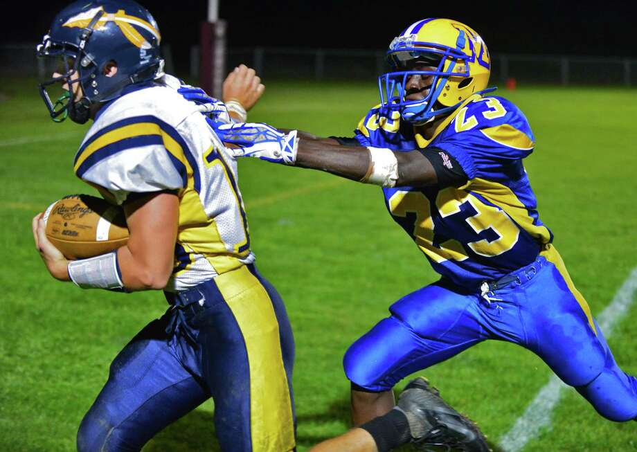 Averill Park's #15 Chris Arnold, left, breaks away from Bishop Maginn's #23 Ky'Ere Tillery at the goal line to score a TD during Friday night's game at Bleecker Stadium Sept. 20, 2013, in Albany, NY.  (John Carl D'Annibale / Times Union) Photo: John Carl D'Annibale / 00023938A