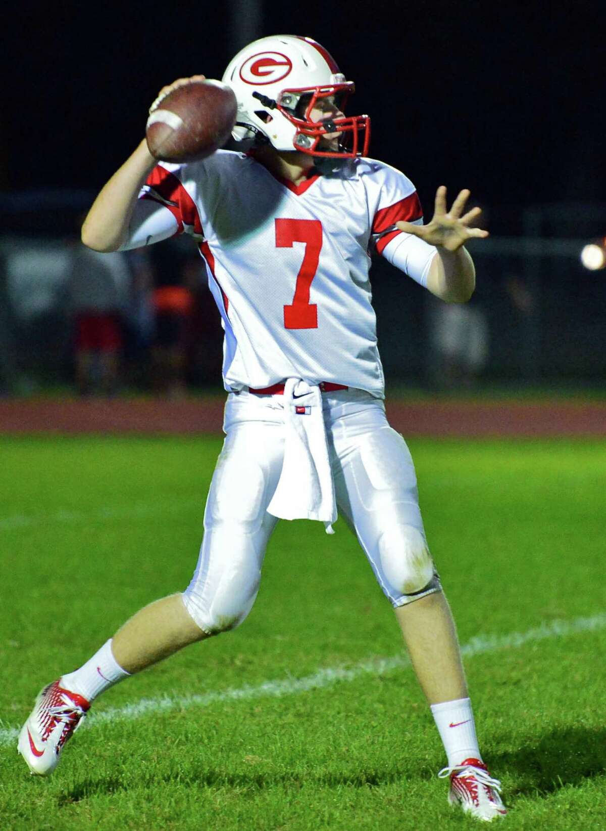 Guilderland QB #7 Frank Gallo gets a pass off during Friday night's game against Bethlehem Sept. 20, 2013, in Delmar, NY. (John Carl D'Annibale / Times Union)