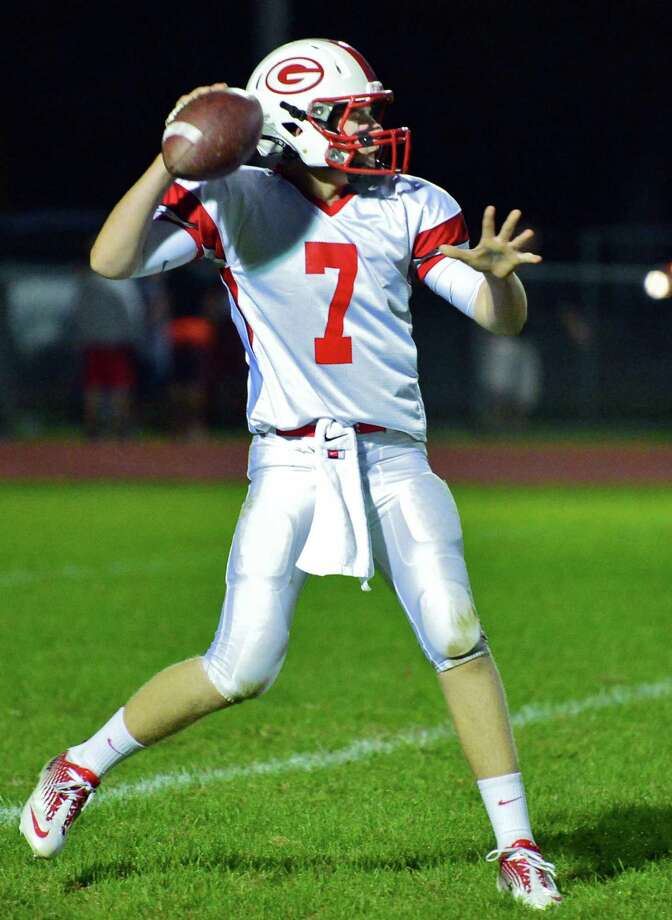 Guilderland QB #7 Frank Gallo gets a pass off during Friday night's game against Bethlehem Sept. 20, 2013, in Delmar, NY.  (John Carl D'Annibale / Times Union) Photo: John Carl D'Annibale / 00023936A