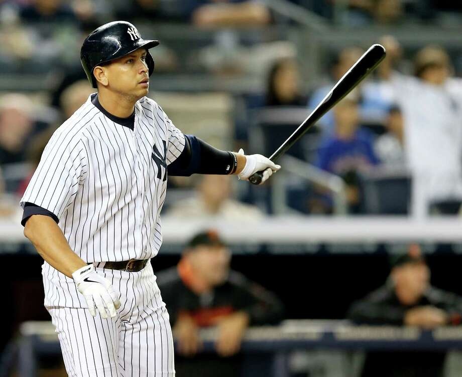 NEW YORK, NY - SEPTEMBER 20:  Alex Rodriguez #13 of the New York Yankees watches his hit fly out of the park and turn into a grand slam in the seventh inning against the San Francisco Giants during interleague  play on September 20, 2013 at Yankee Stadium in the Bronx borough of New York City.  (Photo by Elsa/Getty Images) ORG XMIT: 163495643 Photo: Elsa / 2013 Getty Images