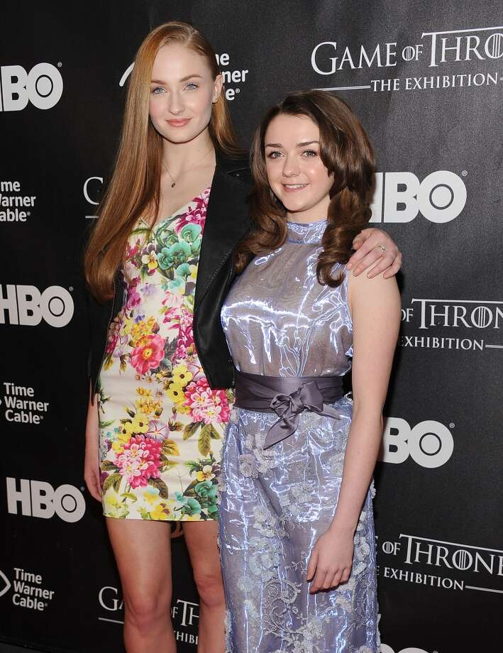Sophie Turner (L) with co-star Maisie Williams on the red carpet. Photo: Gary Gershoff, WireImage