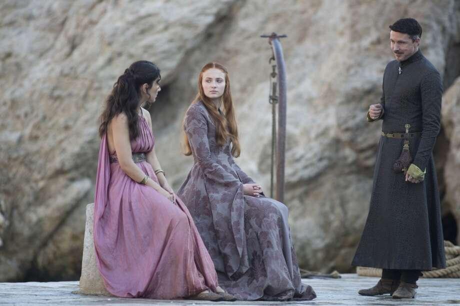 "From L to R: Sibel Kekilli, Sophie Turner, and Aidan Gillen as Petyr ""Littlefinger"" Baelish in Season 3."