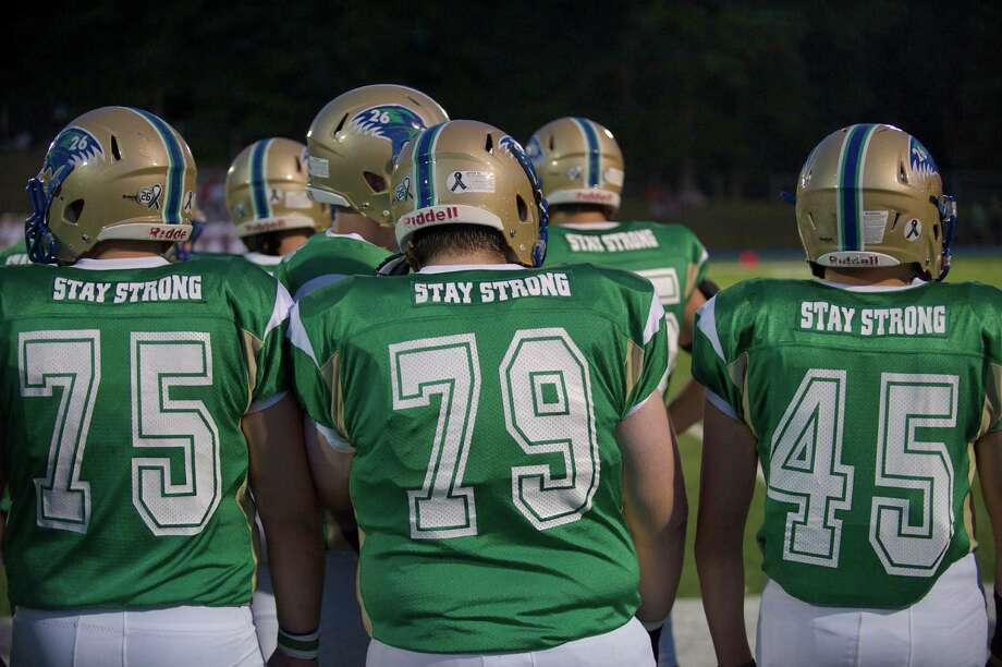 The Newtown boys football team wore special jerseys for their against Bethel High School at Newtown High School, Newtown, Conn on Friday, September 20, 2013. Photo: H John Voorhees III