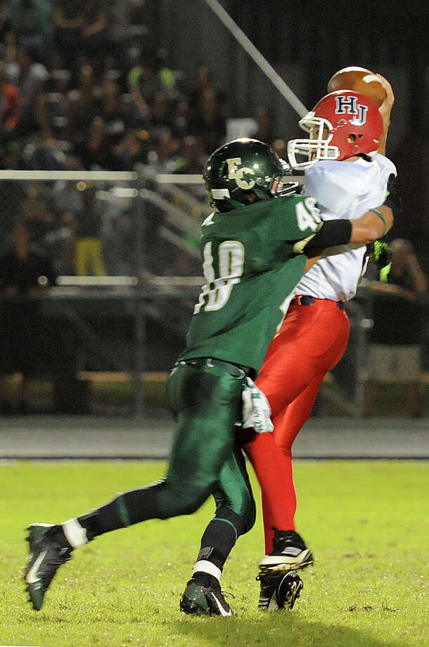 East Chambers' Landon Prejean, 48, puts the pressure on Hardin-Jefferson's Camden DuBois, 8, to force an interception at Buccaneer Stadium Friday night. Photo provided by Drew Loker. Photo: Drew Loker