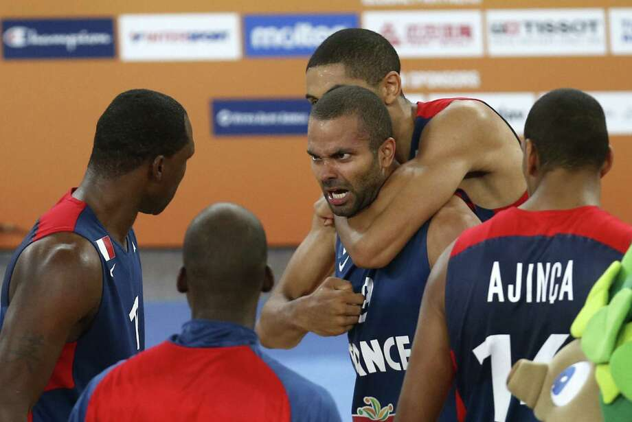 Spurs guard Tony Parker celebrates with his French teammates after beating Spain in overtime in the semifinals of the European championships. France faces Lithuania for the title. Photo: Darko Bandic / Associated Press