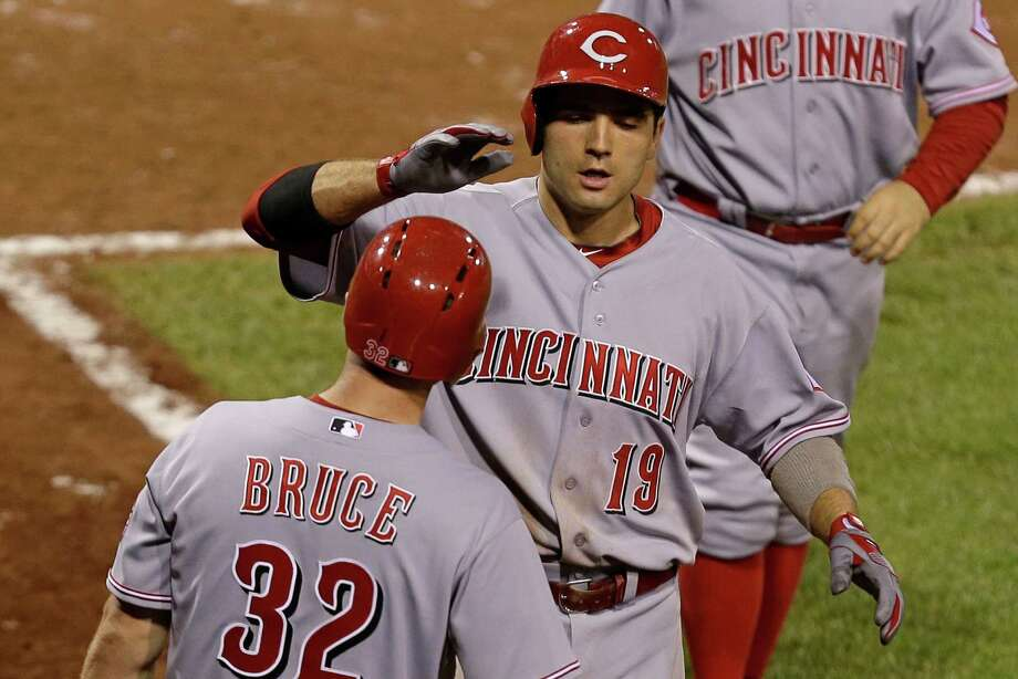 Cincinnati's Joey Votto (19) earns a high-five from Jay Bruce after homering in the 10th inning to give the Reds a 6-5 victory at Pittsburgh. Photo: Gene J. Puskar, STF / AP