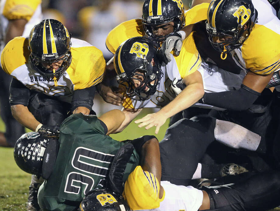 Brennan defenders pile onto Southwest's Bryan Donnell after stopping him at the line of scrimmage at Southwest Stadium. The Bears held the Dragons to 93 yards of offense in their blowout victory. Photo: Tom Reel / San Antonio Express-News
