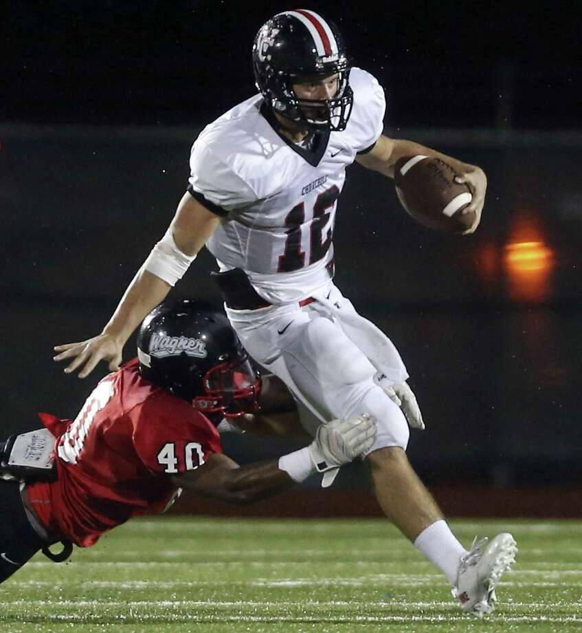 Churchill's Nate Pearson tries to escape the grasp of Wagner's Christopher Dennis in the first half. Pearson had a 4-yard TD run in the game. Photo: Edward A. Ornelas / San Antonio Express-News
