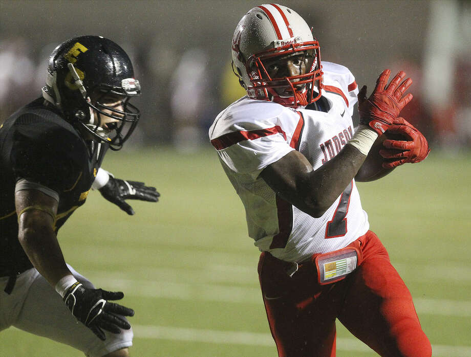 Judson's Jo'Von Kyle veers away from an East Central defender in helping the Rockets romp to victory Friday night at Hornet Stadium. Photo: Kin Man Hui / San Antonio Express-News