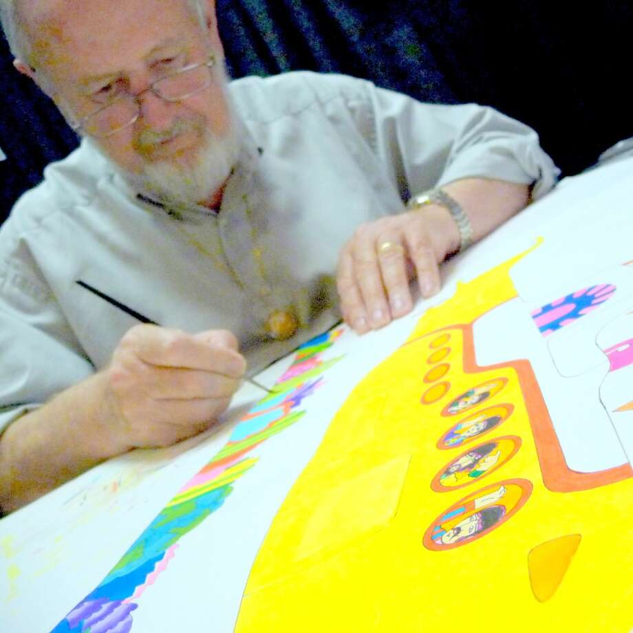 'Yellow Submarine' animator Ron Campell painting a Yellow Submarine. Photo: Picasa