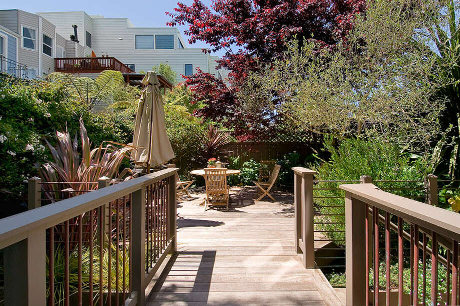 There's also a private rear deck and landscaped gardens. Photo: OpenHomesPhotogaphy.com