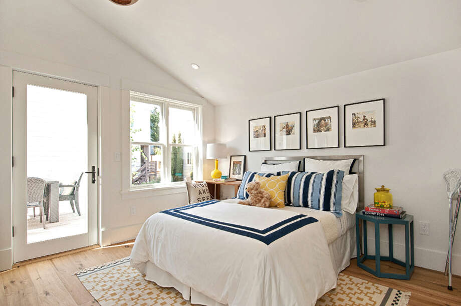 A bedroom has access to an exterior space. Photo: OpenHomesPhotography.com