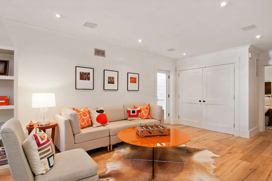 An in-law unit on the ground floor has a private entrance and include two bedrooms. Photo: OpenHomesPhotography.com