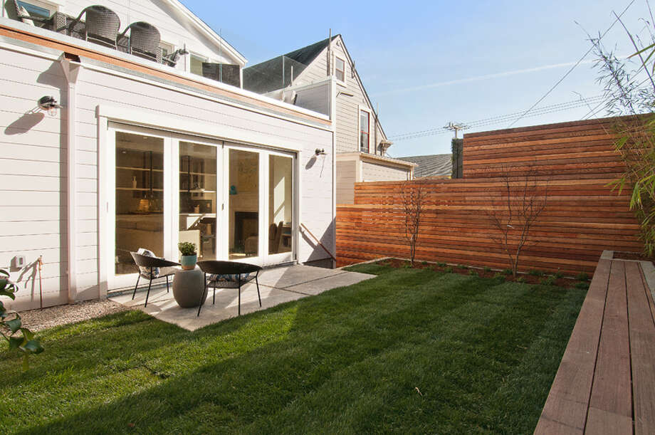 The landscaped yard looking towards the deck. Photo: OpenHomesPhotography.com