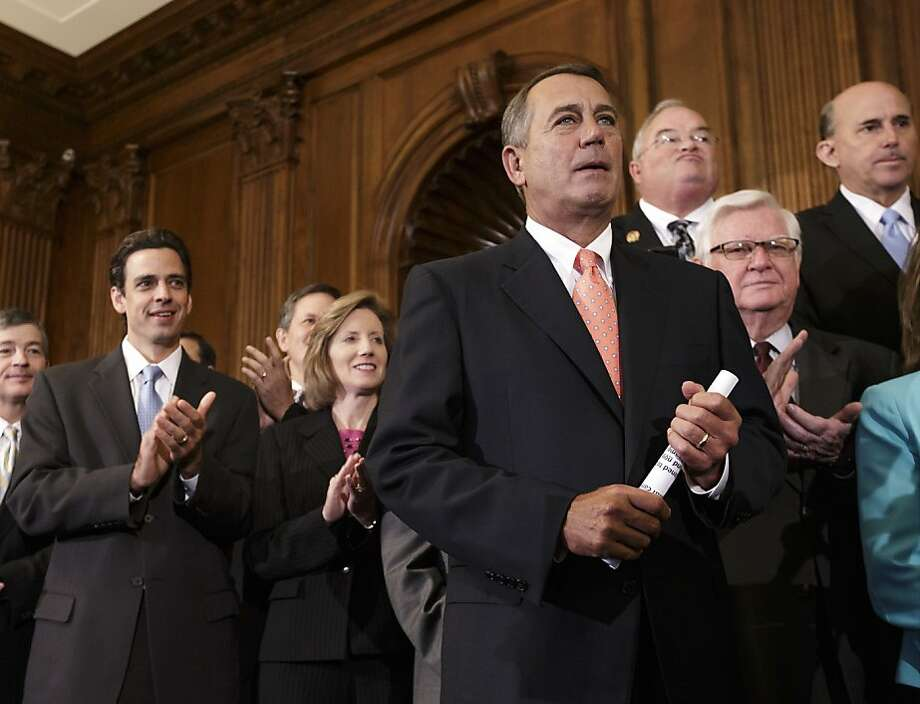 Speaker of the House John Boehner is cheered after the House passed a short spending plan that doesn't fund the health law. Photo: J. Scott Applewhite, Associated Press