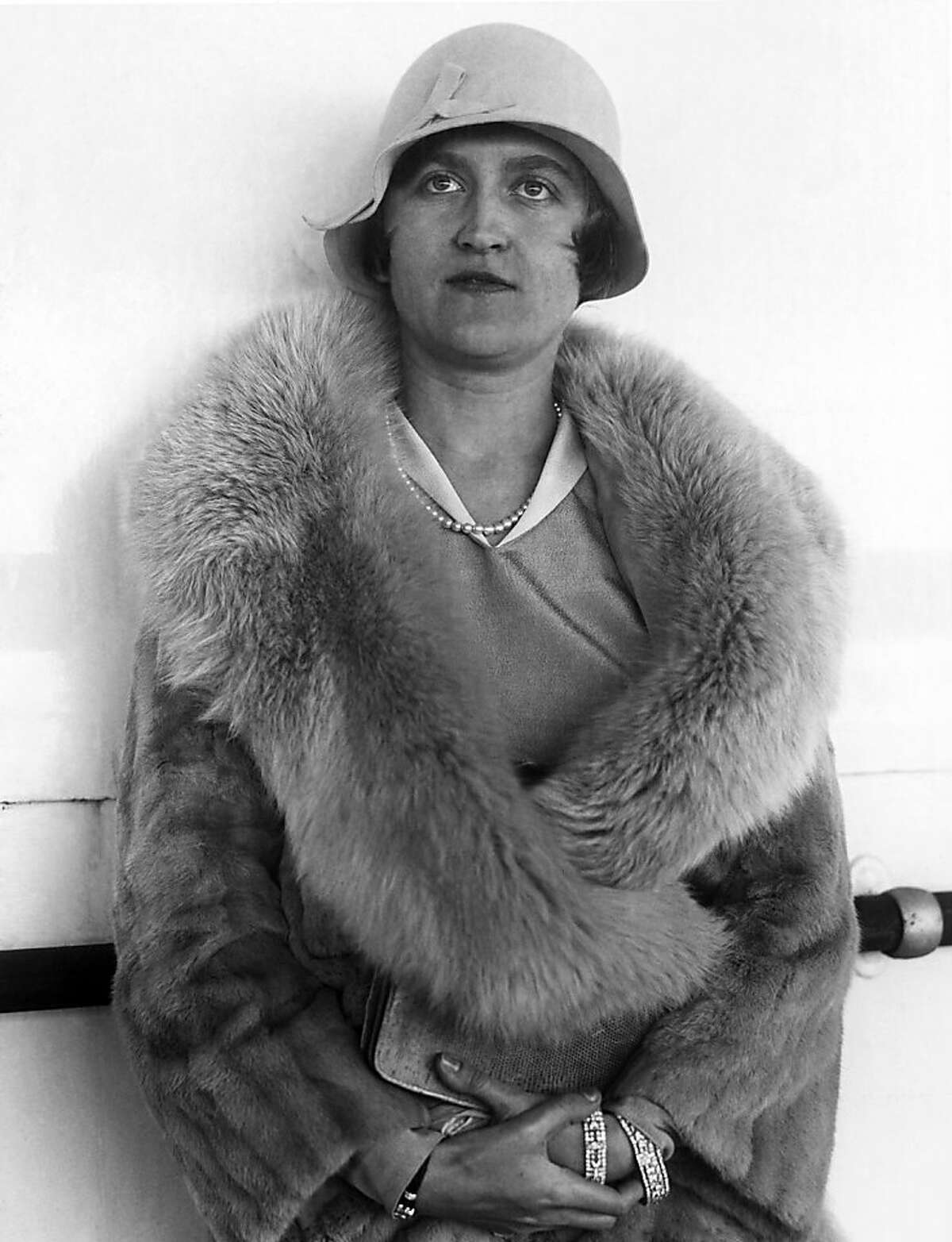 FILE - In this Aug. 11, 1930, file photo, Huguette Clark, a copper magnate from Montana, poses for a photo in Reno, Nev.Lawyers filed a settlement Tuesday, Sept. 24, 2013, in the complex fight over Clark's estate.(AP Photo, File)