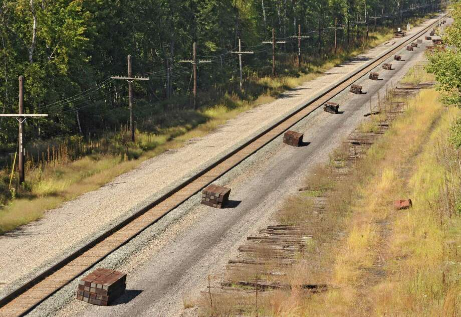 Photo taken from Rt. 155 showing stacks of railroad ties waiting for a second track to be installed on Friday, Sept. 20, 2013 in Colonie, N.Y.  (Lori Van Buren / Times Union) Photo: Lori Van Buren / 00023946A