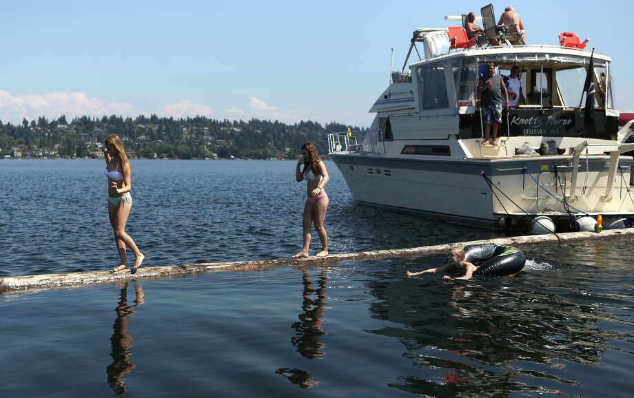 People walk on the log boom during the final day of Seafair. Photo: JOSHUA TRUJILLO, SEATTLEPI.COM / SEATTLEPI.COM