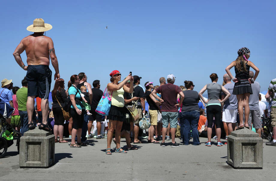 People watch the action from shore as the Seafair Pirates march ashore on July 6 at Alki Beach. Photo: JOSHUA TRUJILLO, SEATTLEPI.COM
