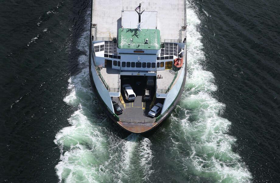 A Washington State Ferry is shown in this aerial photo. Photo: JOSHUA TRUJILLO, SEATTLEPI.COM / SEATTLEPI.COM