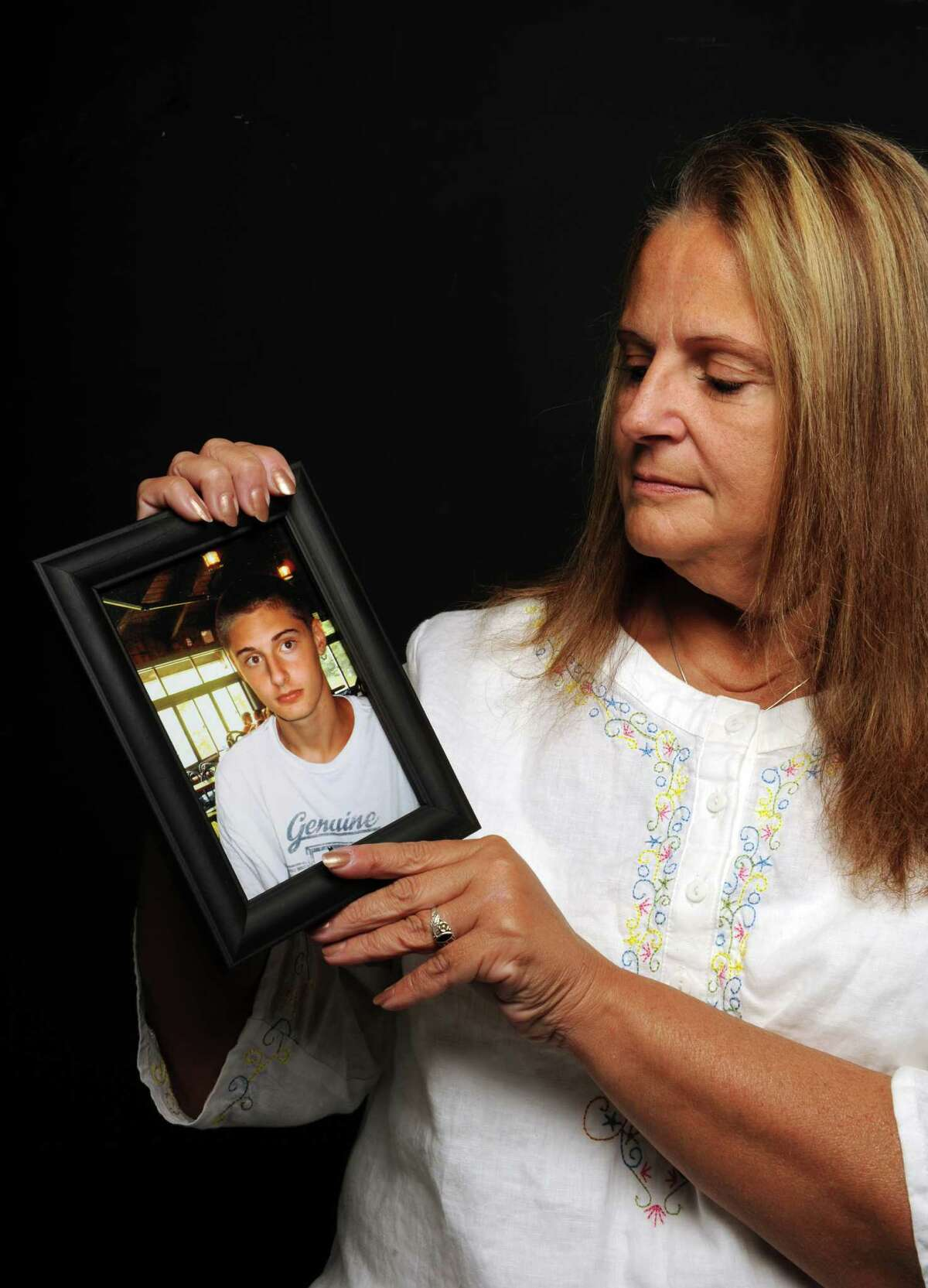 Brenda Auerbach of Averill Park holds a photo of her son Jeremiah Lyman, who died from a heroin overdose last year at just 20 years old. N.Y. (Michael P. Farrell/Times Union)