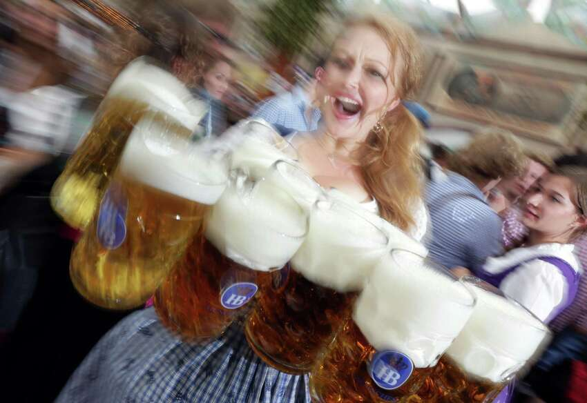 Oktoberfest: Beethoven Maennerchor's celebration of German heritage. Oct. 3-4 and 10-11. Beethoven Halle und Garden, 422 Pereida St. $5. 210-222-1521 or www.beethovenmaennerchor.com. A waitress carries beer mugs during the opening ceremony in the
