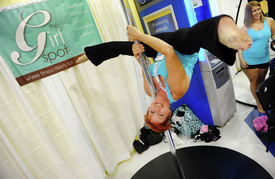 Judy Jovanelly, owner of The Girl Spot in Trumbull, does a pole fitness routine during the Southwest Connecticut Women's Expo at the Webster Bank Arena in Bridgeport, Conn. on Saturday September 21, 2013. The expo features vendors, speakers and demonstrations about health, fitness, education, nutrition, careers, financial planning, home improvement and other topics. Photo: Christian Abraham / Connecticut Post