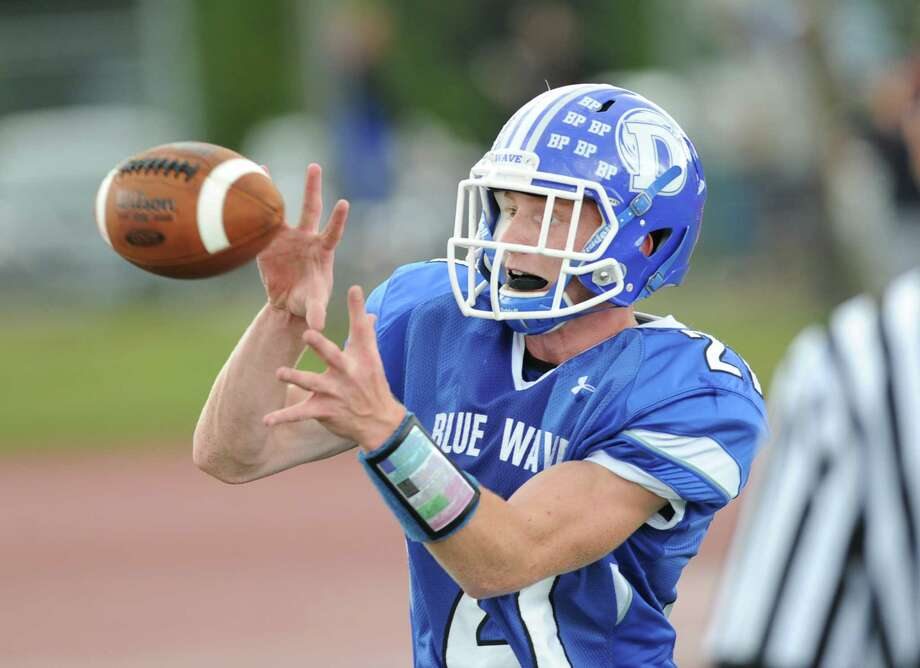 Nicholas Lombardo (# 21) of Darien catches a pass for a two-point conversion during the high school football game between Darien High School and Greenwich High School at Darien, Saturday, Sept. 21, 2013. Darien defeated Greenwich,42-21. Photo: Bob Luckey / Greenwich Time