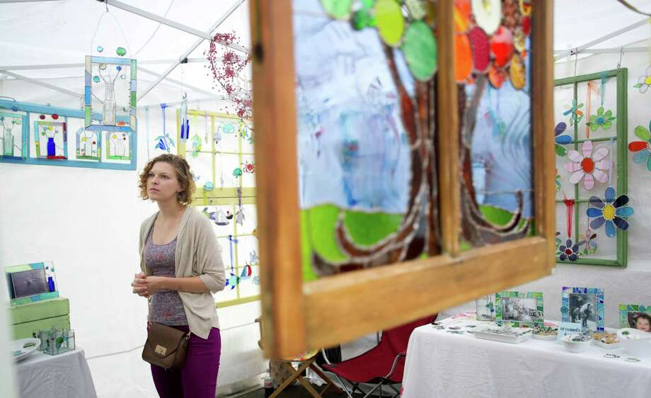 Courtney Sutter looks at a the Summer Glass booth during Arts & Crafts on Bedford in Stamford, Conn., on Saturday, Sept. 21, 2013. Photo: Lindsay Perry / Stamford Advocate