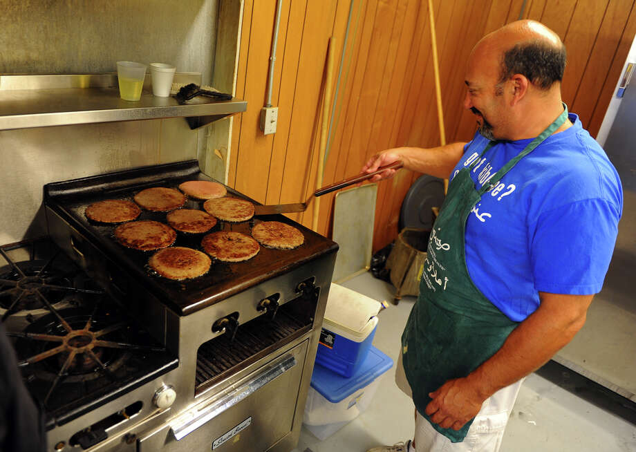 Volunteer Al Gramesty cooks kibbe at the annual Middle Eastern food festival at St. Nicholas Antiochian Orthodox Church in Bridgeport, Conn. on Saturday September 21, 2013. Photo: Christian Abraham / Connecticut Post
