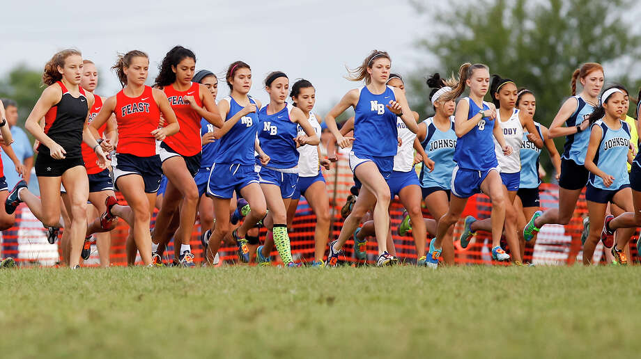 The Gold Girls divison leaves the starting line in the 2013 Ricardo Romo UTSA cross country meet at The National Shooting Comlex on Saturday, Sept. 21, 2013.  The New Braunfels girls team (center) took first place in the event.  MARVIN PFEIFFER/ mpfeiffer@express-news.net Photo: MARVIN PFEIFFER, Marvin Pfeiffer/ Express-News / Express-News 2013