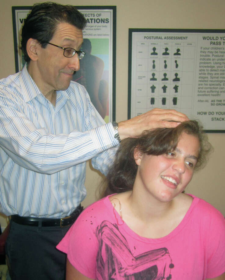 Grace Englund, 14, of Brookfield has shown improvement in her neck ailments courtesy of Dr. Arthur Klein's chiropractic efforts at Family First Chiropractic & Wellness Center in New Milford. September 2013 Photo: Norm Cummings