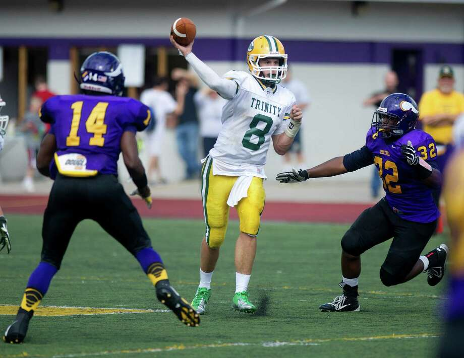Trinity Catholic's Connor Amann throws a pass during Saturday's football game at Westhill High School on Sept. 21, 2013. Photo: Lindsay Perry / Stamford Advocate