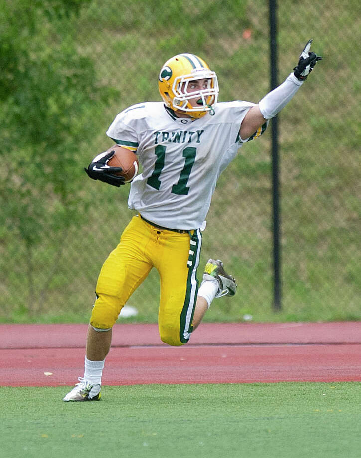 Trinity Catholic's Matt Christensen celebrates after scoring a touchdown during Saturday's football game at Westhill High School on Sept. 21, 2013. Photo: Lindsay Perry / Stamford Advocate