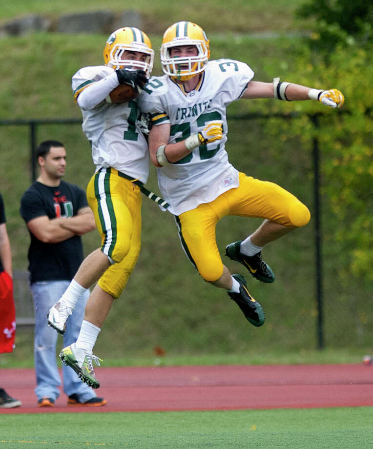 Trinity Catholic's Matt Christensen, left, and Thomas Costigan, right, celebrate after scoring a touchdown during Saturday's football game at Westhill High School on Sept. 21, 2013. Photo: Lindsay Perry / Stamford Advocate