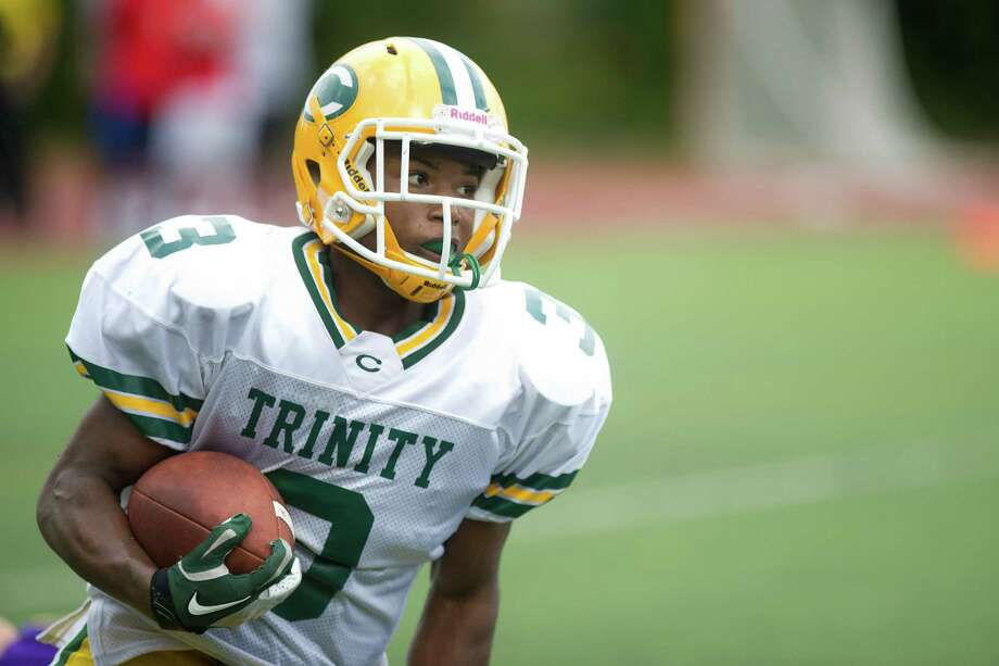 Trinity Catholic plays Westhill during Saturday's football game at Westhill High School on Sept. 21, 2013. Photo: Lindsay Perry / Stamford Advocate